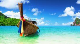 Long boat and tropical beach, Andaman Sea, Phi-Phi, Thailand