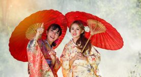 Two girls in kimonos acting are looking beautiful thing.