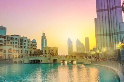 Scenic view of Burj Khalifa Lake, a pool where they dance the Dubai Fountain. On background, the Souk Al Bahar and Burj Khalifa at dusk in Dubai Downtown District, United Arab Emirates.