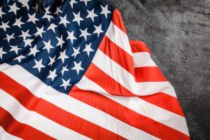 USA flag on dark grey background